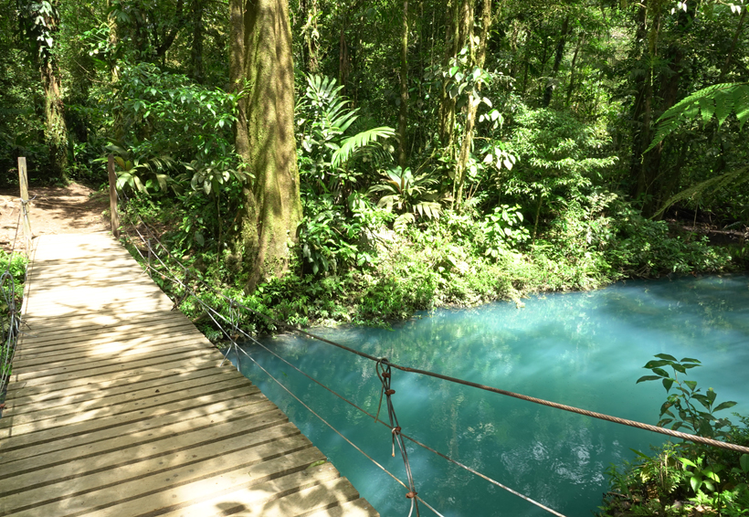 little wooden hang bridge at rio celeste